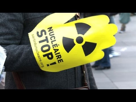 Anti-nuclear protesters gather in Paris on Fukushima anniversary