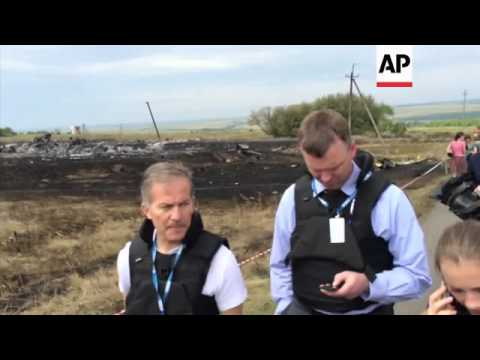 OSCE team at site, bodies in bags being moved by Ukrainian team