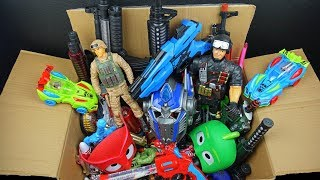 Box Full of Lighted Toy Guns and Weapons - Soldier Figure Pijamasks and Assault Rifles