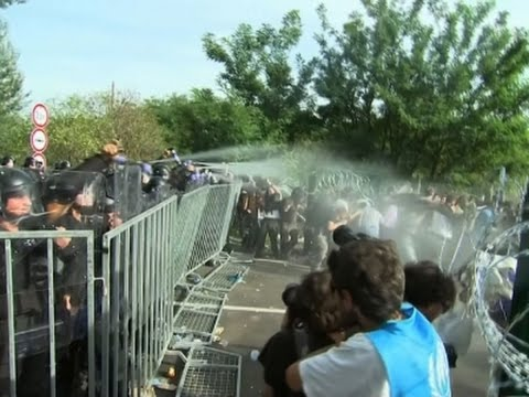 Raw: Hungarian Police Use Tear Gas On Migrants