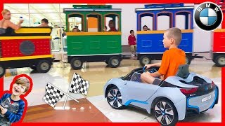 Power Wheels Ride on BMW Racing a Train at the Mall