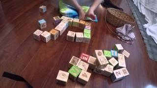 Big Sister Plays with Wooden Blocks