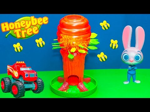 P;laying the Honey Bee Tree Game with Blaze against Zootopia Toys