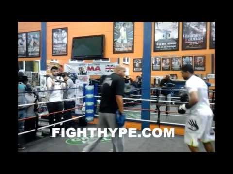 AMIR KHAN WORKS THE MITTS IN PREPARATION FOR LUIS COLLAZO