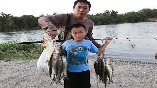 Me, my wife and two sons fishing shad in America River