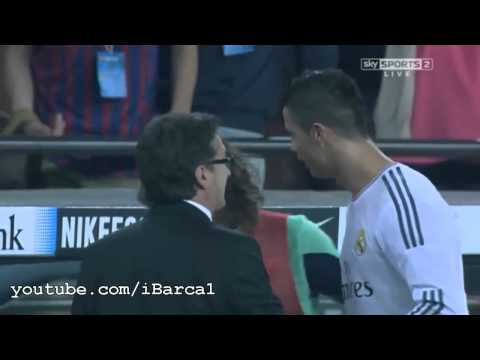 Cristiano Ronaldo talking with Carles Puyol about the penalty after the match