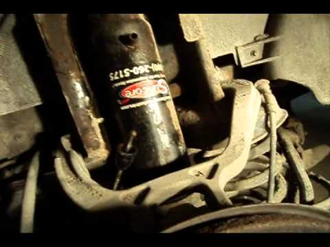 1994 Cadillac Deville: Shock Absorber Removal