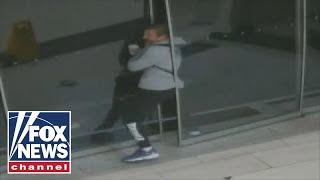 Raw video shows burglar getting stuck in sliding door