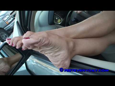 Hot chic with really wrinkled soles and tan legs.mpg