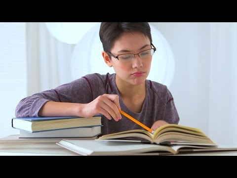 Mixed Race Asian Woman Studying. Stock Footage