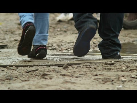 Footsteps on a dirty surface, tropical Asia storm aftermath. Stock Footage