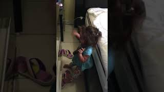 Funny baby girl talking alone