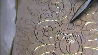 Rose and Scroll Gun engraving style hand engraving on a Zippo lighter part 1