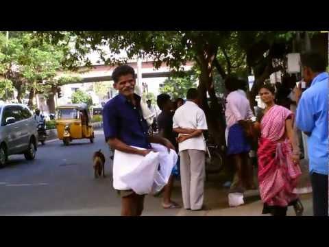 Tourist drinking chai on TTK Road outside Hotel Raj Park, Chennai, India