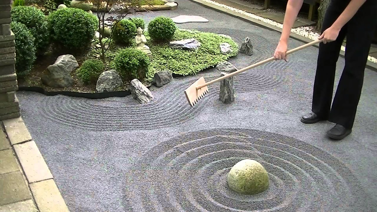 Japanese zen garden raking youtube for Japanese meditation garden design