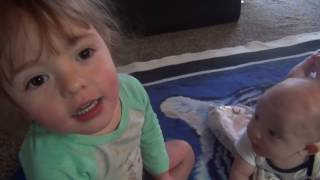Baby  laughing / Playing with toddler Sister