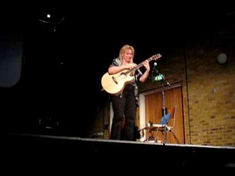Jennifer Batten playing guitar