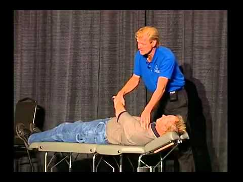 Dr. Allan Oolo Austin teaches Trigenics shoulder assessment and treatment at SWIS conference.