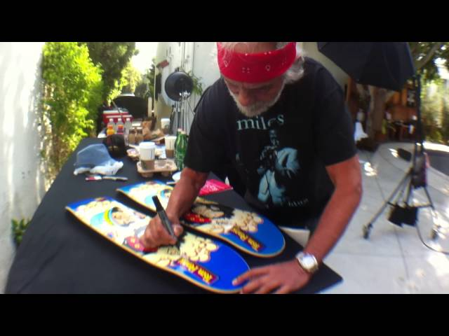 "Cheech & Chong signing a Flip ""Tom & Friends"" skateboard"