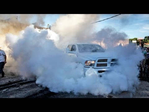 4X4 BURNOUT - 15,000lbs Dumpster vs 8000lbs Dodge Ram Pickup