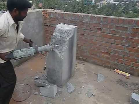 Tritherm Rcc Concrete Demolishing By Hitachi Ph 65 Breaker