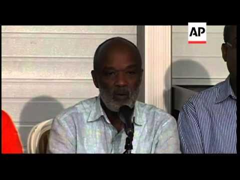 Deaths as hurricane floods Haiti quake area, Turks preps
