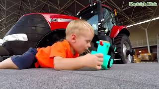 Baby Playing Toy Truck - Kayleigh Kirk