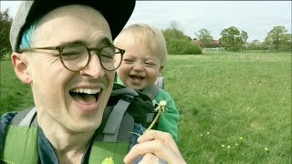 Cute kid finds blowing dandelion funny