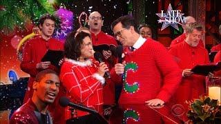 "Norah Jones And Stephen Colbert Sing ""Christmas Is Now"""