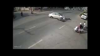 Motorbike runs red light and hits car with full speed