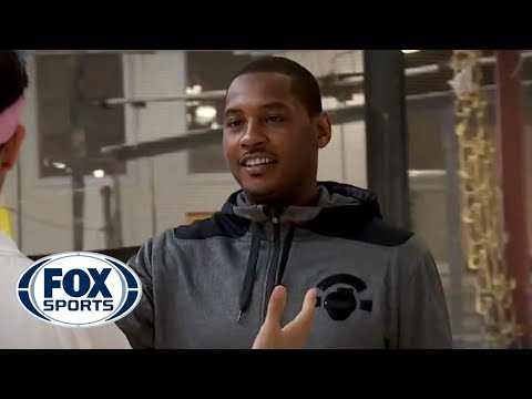 Carmelo Anthony plays basketball as President Obama