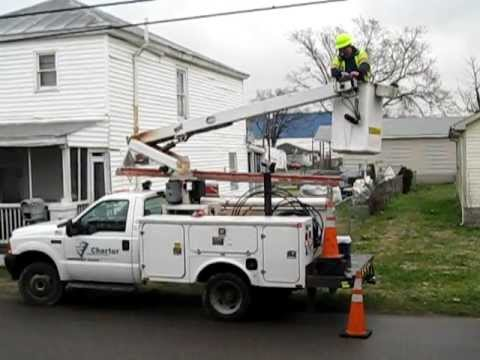 Charter Communications bucket truck working on overhead cable. Suffolk, VA