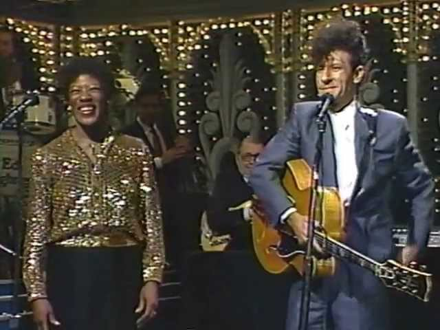 """Lyle Lovett & Francine Reed on Johnny Carson's show, """"What Do You Do"""", 1989"""