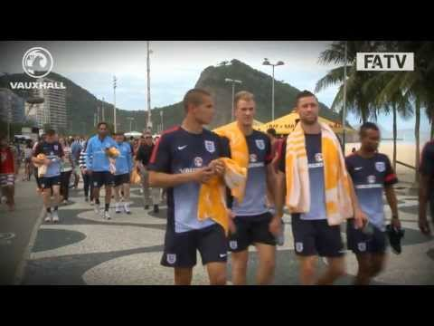 England stretch on Copacabana beach after arriving in Rio de Janeiro, Brazil