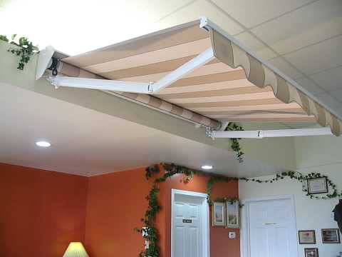 Retractable awnings, canopies, manual awnings, automatic awnings, Rolltec Awnings Canada,