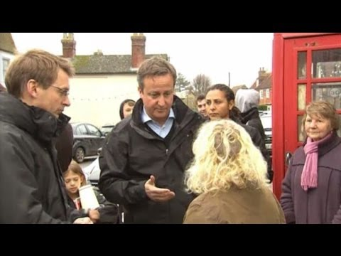 David Cameron confronted by angry resident in flood-hit village