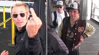 See How Green Day Bassist Mike Dirnt Reacts When They Get Papparazi'd At LAX
