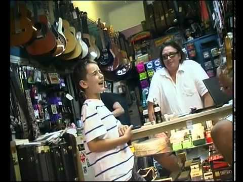 Kid singing the blues in a music store.