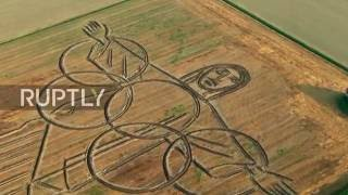 Italy: Land artist ploughs giant Olympics tribute with tractor