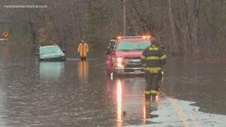 SUV gets stuck in water in Milford
