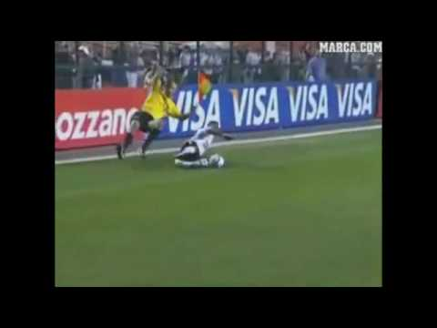 funny football - a player accidently slide tackles the assistant referee!!