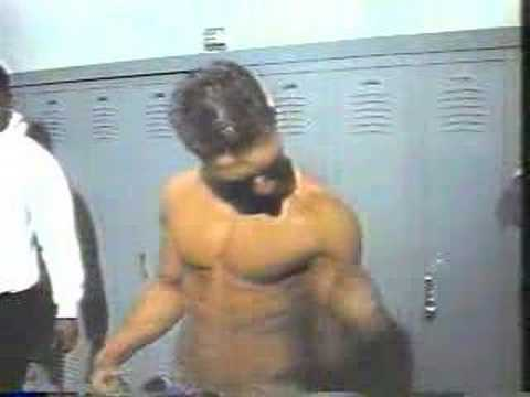 Teen bodybuilder flexing in the locker room
