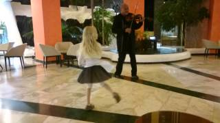 Lanzarote child 5 years old dance with violinist Pablo in hotel Sandos Papagayo Beach resort