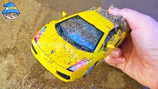 Washing car toys. Finding toys in the sand play. Construction vehicle toys.
