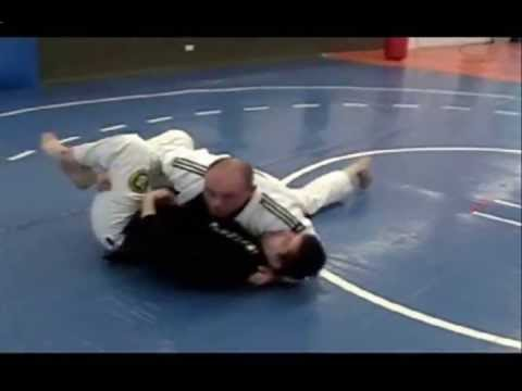 BJJ Techniques: Escaping Bottom Half-Guard to 100 Kilos Side Control Image 1