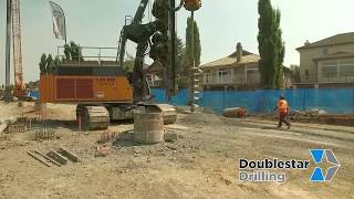 Slope Stabilization Pile Wall with Doublestar Drilling's Liebherr LB28's & HS855 Crane