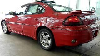 Victory Red 2004 Pontiac Grand Am GT V6 @ Eastside Mazda Volkswagen in Cleveland, Ohio