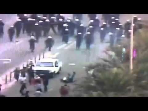 Rioters run over police in Bahrain protests 13 3 2011