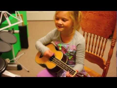 Emma, (Foreverland's Buttercup) playing ukulele and singing