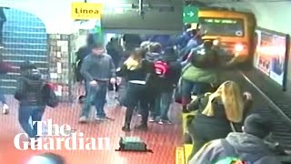 Bystanders rescue woman after she falls onto train tracks in Argentina